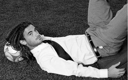 kyle beckerman laying on the ground head resting on a ball