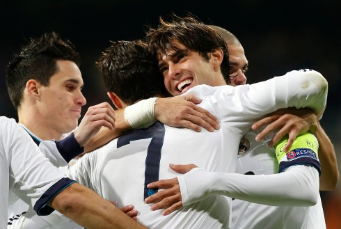 Real Madrid's Kakais embraced by his teammate Ronaldo during their Champions League Group D soccer match against Ajax Amsterdam at Santiago Bernabeu stadium in Madrid
