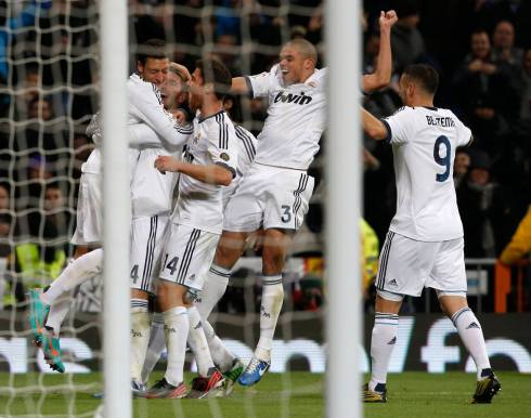 Real Madrid's Mesut Ozil celebrates his goal against Atletico Madrid with his teammates during their Spanish first division soccer match at Santiago Bernabeu stadium in Madrid