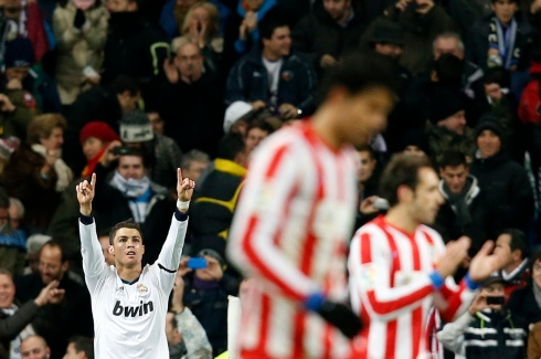 Real Madrid's Cristiano Ronaldo celebrates his goal against Atletico Madrid during their Spanish first division soccer match at Santiago Bernabeu stadium in Madrid