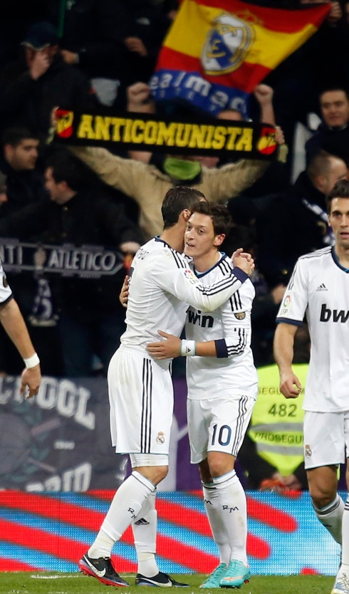 Real Madrid's Ozil celebrates scoring against Atletico Madrid during their Spanish first division soccer match in Madrid