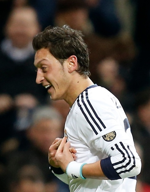 Real Madrid's Mesut Ozil celebrates his goal against Atletico Madrid during their Spanish first division soccer match at Santiago Bernabeu stadium in Madrid
