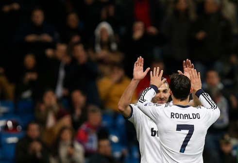Real Madrid's Cristiano Ronaldo celebrates his goal against Ajax Amsterdam with teammate Karim Benzema during their Champions League Group D soccer match at the Santiago Bernabeu stadium in Madrid