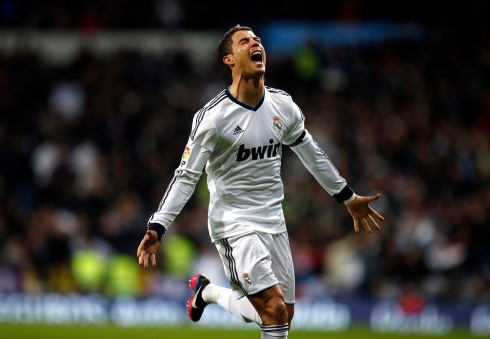 Real Madrid's Cristiano Ronaldo celebrates scoring against Atletico Madrid during their Spanish first division match in Madrid