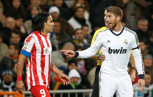 Atletico Madrid's Radamel Falcao argues with Real Madrid's Sergio Ramos during their Spanish first division soccer match at Santiago Bernabeu stadium in Madrid