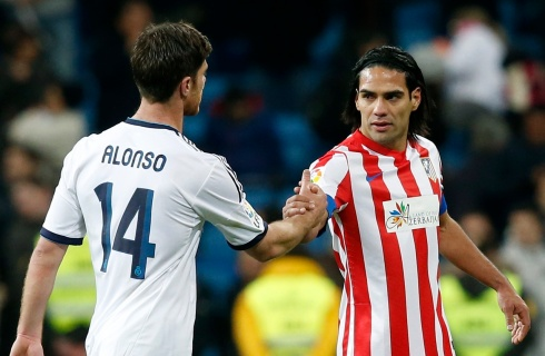 Atletico Madrid's Radamel Falcao shakes hands with Real Madrid's Xabi Alonso after their Spanish first division soccer match in Madrid