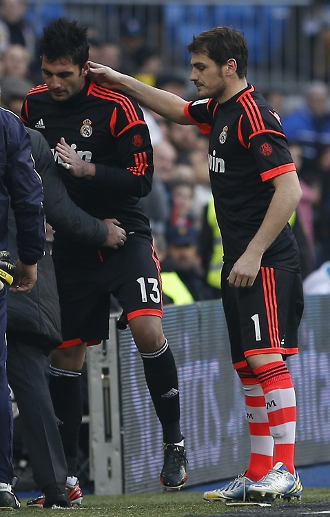 Real Madrid's goalkeeper Casillas consoles teammate Adan after Adan received a red card during their Spanish first division soccer match against Real Sociedad in Madrid