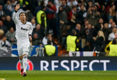 Real Madrid's Cristiano Ronaldo reacts after scoring against Manchester United during their Champions League soccer match at Santiago Bernabeu stadium in Madrid