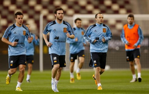 Spain's soccer team players exercise during a training session at Khalifa stadium in Doha