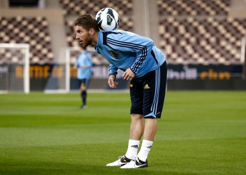 Spain's national soccer player Sergio Ramos controls the ball during a training session at Khalifa stadium in Doha