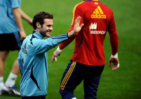 Spain's Mata waves during a training session at El Molinon stadium in Gijon