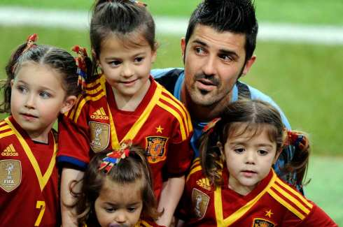 Spain's player Villa poses with his daughters and nieces after a training session at El Molinon stadium in Gijon