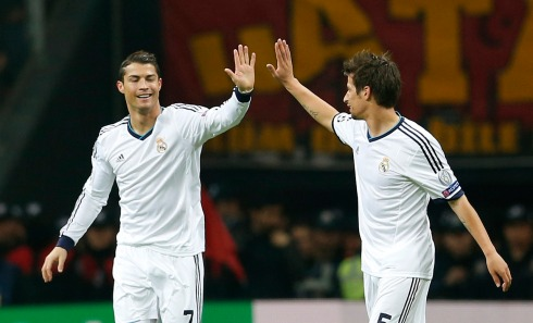 Real Madrid's Ronaldo celebrates with his team mate Coentrao after scoring a goal against Galatasaray during their Champions League quarter-final second leg soccer match in Istanbul