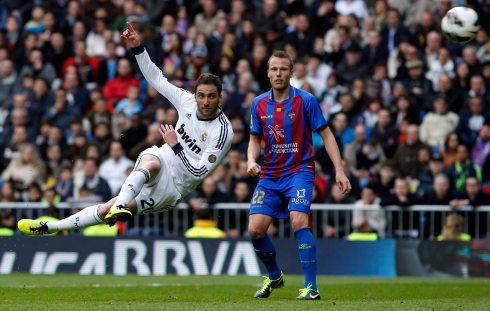 Real Madrid's Higuain kicks the ball to score a goal past Levante's Lell during their Spanish first division soccer match in Madrid