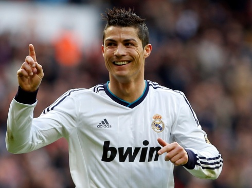 Real Madrid's Cristiano Ronaldo celebrates after scoring a goal against Levante during their Spanish first division soccer match at Santiago Bernabeu stadium in Madrid