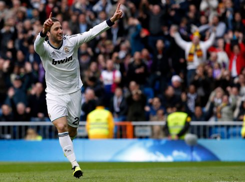 Real Madrid's Higuain celebrates after scoring a goal against Levante during their Spanish first division soccer match in Madrid