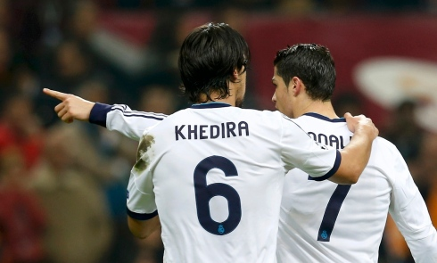 Real Madrid's Ronaldo celebrates with his team mate Khedira after scoring a goal against Galatasaray during their Champions League quarter-final second leg soccer match in Istanbul