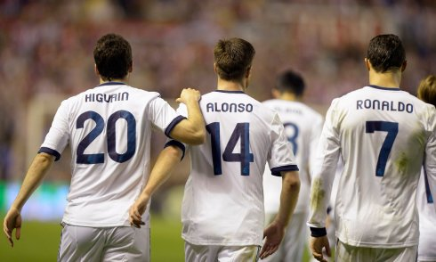Real Madrid's Higuain, Alonso and Ronaldo celebrate goal by Higuain against Athletic Bilbao during their Spanish first division soccer match in Bilbao