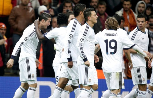 Real Madrid's Ronaldo celebrates with his team mates after scoring a goal against Galatasaray during their Champions League quarter-final second leg soccer match in Istanbul