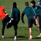 Real Madrid's Ronaldo smiles with team mates as they stretch during a training session at club's training grounds in Madrid