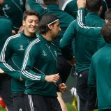 Real Madrid's Khedira and Oezil warm up during a training session in Dortmund
