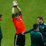Real Madrid's Casillas stretches during a training session in Dortmund