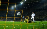 Real Madrid's Ronaldo scores a goal past Borussia Dortmund's Lukasz Pisczek in Champions League semi-final first leg soccer match in Dortmund