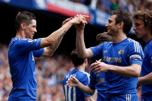 Chelsea's Torres celebrates with team mate Lampard after scoring against Everton in London