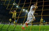 Real Madrid's Higuain picks up ball as Borussia Dortmund's Hummels reacts after conceding a goal in Champions League semi-final first leg soccer match in Dortmund