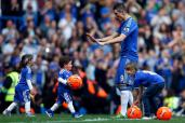 Chelsea's Torres plays with his son Leo and daughter Nora after their English Premier League soccer match against Everton in London