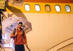 Spain's national soccer team player Fernando Torres walks off the plane carrying an umbrella, in Recife, ahead of the Confederations Cup
