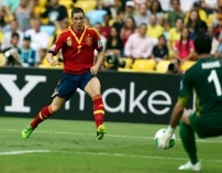 Spain's Fernando Torres shoots to score against Tahiti's goalkeeper Mikael Roche during their Confederations Cup Group B soccer match at the Estadio Maracana in Rio de Janeiro