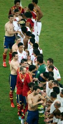 Spain and Tahiti players shake hands after their Confederations Cup Group B soccer match at the Estadio Maracana in Rio de Janeiro