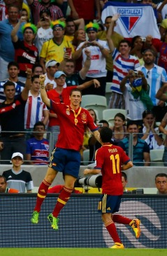 Spain's Torres celebrates after scoring a goal during their Confederations Cup Group B soccer match against Nigeria at the Estadio Castelao in Fortaleza