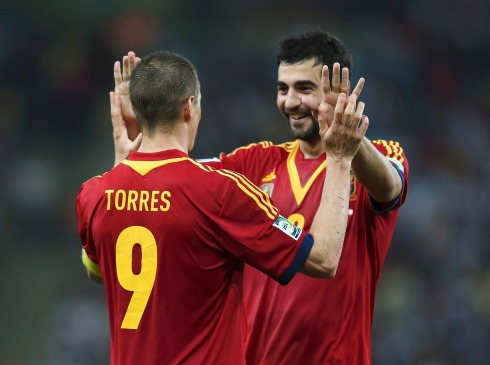 Spain's Fernando Torres celebrates with teammate Raul Albiol after scoring his fourth, and the team's ninth goal against Tahiti during their Confederations Cup Group B soccer match at the Estadio Maracana in Rio de Janeiro
