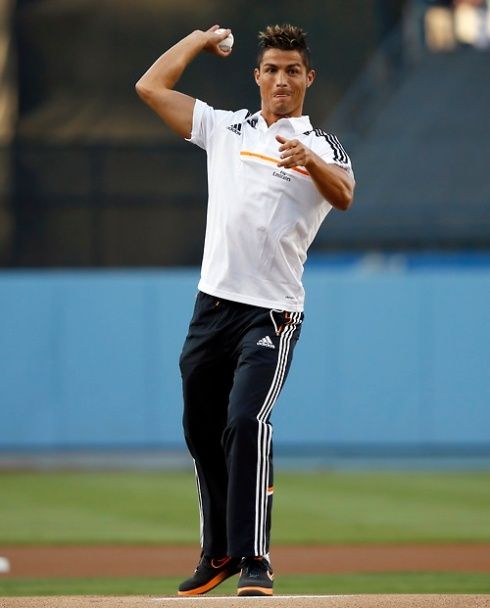 Real Madrid's Ronaldo throws the ceremonial first pitch before the Interleague MLB baseball game between the Yankees and the Dodgers in Los Angeles