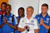 Chelsea manager Jose Mourinho, Ramires and Branislav Ivanovic gesture as they arrive at Bangkok Suvarnabhumi Airport