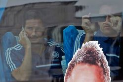 Chelsea players Frank Lampard and John Terry look at fans as they arrive at Bangkok Suvarnabhumi Airport