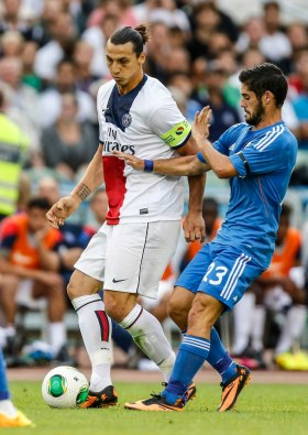 Paris St Germain's Ibrahimovic and Real Madrid's Isco fight for the ball during a friendly soccer match in Gothenburg