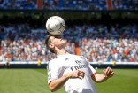 Gareth Bale of Wales heads a ball at the Santiago Bernabeu stadium in Madrid