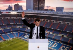 Gareth Bale of Wales waves at new new Real Madrid soccer club on the Santiago Bernabeu stadium in Madrid,