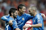 Real Madrid's Ronaldo celebrates a goal with team mates Isco and Benzema against Galatasaray during their Champions League soccer match in Istanbul