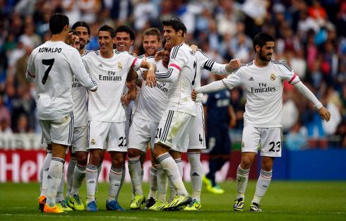 Real Madrid's Angel Di Maria celebrates with teammates after scoring a goal during their Spanish first division soccer match against Malaga at Santiago Bernabeu stadium in Madrid