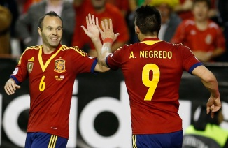 Spain's Alvaro Negredo celebrates his goal with his teammate Andres Iniesta during their 2014 World Cup qualifying soccer match against Georgia at Carlos Belmonte stadium in Albacete
