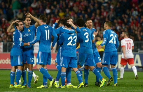 Real Madrid's Gareth Bale celebrates with teammates after scoring against Almeria during their soccer match in Almeria