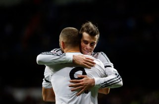 Real Madrid's Benzema celebrates his goal against Real Valladolid with teammate Bale during their Spanish First Division soccer match at Santiago Bernabeu stadium in Madrid