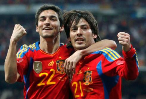 Spain's Silva celebrates with team mate Navas after scoring a goal against Colombia during their international friendly soccer match in Madrid