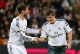 Chess world champion Magnus Carlsen shakes hands with Real Madrid's Sergio Ramos after taking an honorary kickoff before the Spanish First Division soccer match between Real Madrid and Real Valladolid, at Santiago Bernabeu stadium