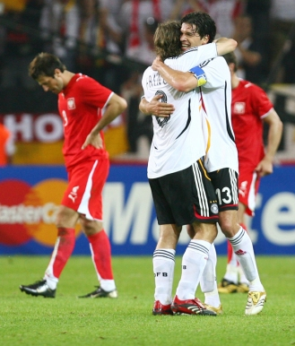 Germany's Michael Ballack and Torsten Frings celebrate win over Poland after Group A World Cup 2006 soccer match in Dortmund