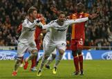 Real Madrid's Higuain celebrates his goal with captain Ramos passing by Galatasaray Nounkeu